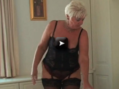 Curvy old mature in black stockings