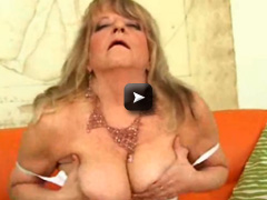 OlderWomanFun Granny with saggy tits fucks a giant dildo