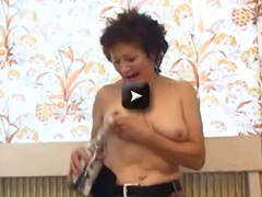 OlderWomanFun Over 60 granny fucks a bottle