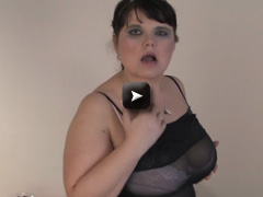Dirty housewife plaing with a dildo